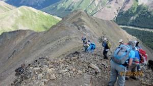Dropping down to follow the ridge